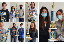 DECA Students with trophies