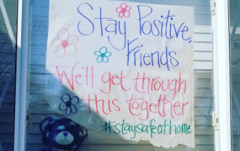 positive poster in window