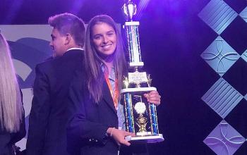 Ella Brennaman with trophy