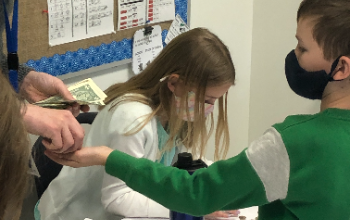 student counting money