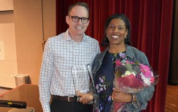 Ericka Simmons receiving an award