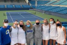 girls tennis team with masks