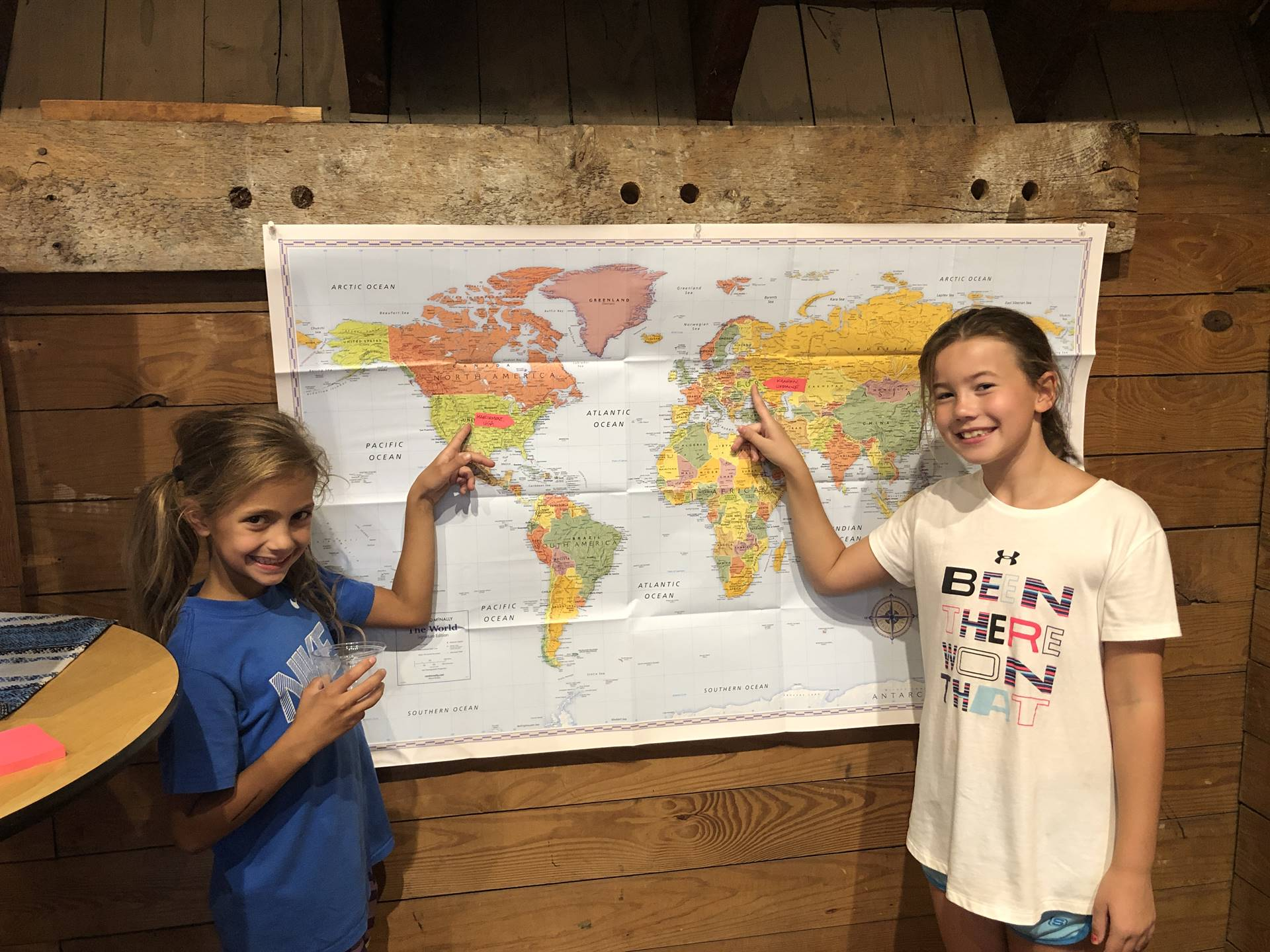 students pointing to map