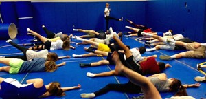 Students and teacher stretching